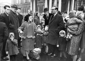 Councillor JW Kennedy, MO, chairman of the Corporations estates and markets committee, meets a deputation of housewives who protested at the City Hall against a plague of rate which are terrorosong tenants at Orangefield Bungalows, of the Castlereagh Road.  22/2/1966