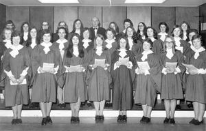"""Mr. Tom Greenwood (centre back row), with the Ballymena Academy girls' choir who took part in """"A cermony of carols,"""" at the musical concert held in the school assembly hall, 1971."""