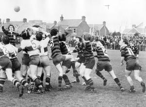 Ballymena Academy players clamour for the ball after a line-out during the Schools' Cup-final against Belfast Boys' Model School, at Ravenhill, 1971.