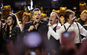 Robbie Williams and Take That's Gary Barlow join stars on stage