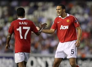Rio Ferdinand of Manchester United congratulates Nani for supplying the cross for the winning goal during the UEFA Champions League Group C match between Valencia and Manchester United at the Mestalla Stadium on September 29, 2010 in Valencia, Spain