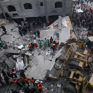 Palestinian firefighters work at the scene of an Israeli air strike on a building in the Jebaliya refugee camp in the northern Gaza Strip (AP)