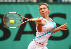 Before: Simona Halep's 34DD breasts were proving prohibitive
