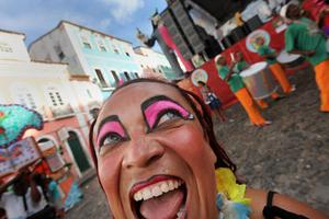 SALVADOR, BRAZIL - FEBRUARY 17:  A reveler dances in a parade on the second day of Carnival celebrations on February 17, 2012 in Salvador, Brazil. Carnival is the grandest holiday in Brazil, annually drawing millions in raucous celebrations culminating on Fat Tuesday before the start of the Catholic season of Lent which begins on Ash Wednesday. Salvador is the capital of the Northeastern state of Bahia and was the first colonial capital of Brazil. Police strikes in Salvador and Rio de Janiero in recent weeks threatened Carnival and raised questions about the countryÄôs preparedness to host the upcoming 2014 World Cup and 2016 Summer Olympics. Rio de JanieroÄôs Carnival began today, a day later than SalvadorÄôs. (Photo by Mario Tama/Getty Images)
