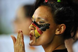 KHARKOV, UKRAINE - JUNE 13:  A Germany fan has her face painted prior to the UEFA EURO 2012 group B match between Netherlands and Germany at Metalist Stadium on June 13, 2012 in Kharkov, Ukraine.  (Photo by Lars Baron/Getty Images)
