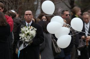 FAIRFIELD, CT - DECEMBER 17:  People arrive for the funeral services of six year-old Noah Pozner, who was  killed in the shooting massacre in Newtown, CT, at Abraham L. Green and Son Funeral Home on December 17, 2012 in Fairfield, Connecticut. Today is the first day of funerals for some of the twenty children and seven adults who were killed by 20-year-old Adam Lanza on December 14, 2012.  (Photo by Spencer Platt/Getty Images)