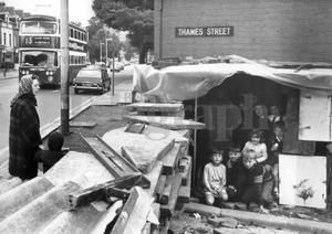 Riots : Belfast. August 1969.  Children playing in the sentry box erected by vigilantes at Thames Street, Belfast.  The box is used by the residents who guard the street during the hours of darkness.  (23/8/69)