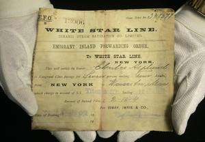 A unique emigrant inland forwarding order to the White Star office in New York, is seen at Henry Aldridge and Son auctioneers in Devizes, Wiltshire, England Thursday, April 3, 2008. The locket and one of the rings were recovered from the body of Carl Asplund who drowned on the Titanic, they are all part of the Lillian Asplund collection of Titanic related items.