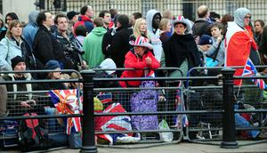 People gather outside Buckingham Palace, London, on the morning of the royal wedding. PRESS ASSOCIATION Photo. Picture date: Friday April 29, 2011. See PA story WEDDING. Photo credit should read: Rui Vieira/PA Wire