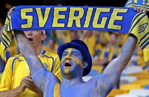 A Swedish fan holds a scarf prior to the  Euro 2012 soccer championship Group D match between Ukraine and Sweden in Kiev, Ukraine, Monday, June 11, 2012. (AP Photo/Efrem Lukatsky)
