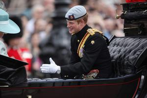 LONDON, ENGLAND - JUNE 16:  Prince Harry leaves Buckingham Palace for the Trooping the Colour ceremony at the Horse Guards Parade on June 16, 2012 in London, England. The annual ceremony, made up of more than 600 guardsmen and cavalry, is believed to have first been performed during the reign of King Charles II. The parade marked the official birthday of the Sovereign, even though the Queen's actual birthday is on April 21st.  (Photo by Dan Kitwood/Getty Images)