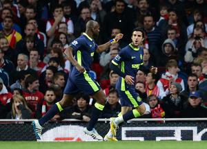 LONDON, ENGLAND - APRIL 16: Jordi Gomez of Wigan celebrates scoring their second goal with Emmerson Boyce of Wigan during the Barclays Premier League match between Arsenal and Wigan Athletic at Emirates Stadium on April 16, 2012 in London, England.  (Photo by Laurence Griffiths/Getty Images)