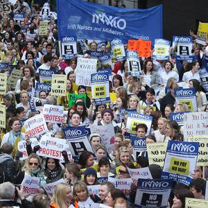 The Irish Nurses and Midwives Organisation is calling for a nationwide mortgage strike over bailouts and budget cuts
