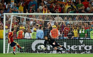 DONETSK, UKRAINE - JUNE 27: Andres Iniesta of Spain scores a penalty during the UEFA EURO 2012 semi final match between Portugal and Spain at Donbass Arena on June 27, 2012 in Donetsk, Ukraine.  (Photo by Jasper Juinen/Getty Images)