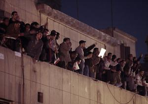Egyptian anti-government activists chant slogans as they gather on the rooftop of the Lawyers Syndicate in downtown Cairo, Egypt, Wednesday, Jan. 26, 2011. Egyptian anti-government activists clashed with police for a second day Wednesday in defiance of an official ban on any protests but beefed up police forces on the streets quickly moved in and used tear gas and beatings to disperse demonstrations. (AP Photo/Lefteris Pitarakis)