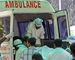 A terrorist attack victim's body is shifted to an ambulance to be taken for postmortem outside the St. Georges Hospital in Mumbai, India, Thursday, Nov. 27, 2008. Teams of gunmen stormed luxury hotels, a popular restaurant, hospitals and a crowded train station in coordinated attacks across India's financial capital, killing at least 101 people, taking Westerners hostage and leaving parts of the city under siege Thursday, police said. A group of suspected Muslim militants claimed responsibility. (AP Photo/Gurinder Osan)