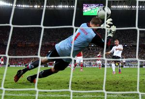 L'VIV, UKRAINE - JUNE 17: Lukas Podolski of Germany scores their first goal past Stephan Andersen of Denmark during the UEFA EURO 2012 group B match between Denmark and Germany at Arena Lviv on June 17, 2012 in L'viv, Ukraine.  (Photo by Alex Livesey/Getty Images) *** BESTPIX ***