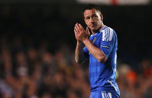 LONDON, ENGLAND - APRIL 04:  John Terry of Chelsea applauds the fans as he leaves the field during the UEFA Champions League Quarter Final second leg match between Chelsea and Benfica at Stamford Bridge on April 4, 2012 in London, England.  (Photo by Warren Little/Getty Images)