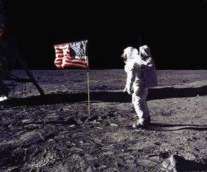 <b>The fluttering flag</b><br/> Why does the US flag planted appear to be fluttering in a breeze when the astronauts are in a vacuum?   The flag had a pole inserted across the top so that it would look right in the photographs. The astronauts didn't extend the pole fully and the flag was left with a crease in it.