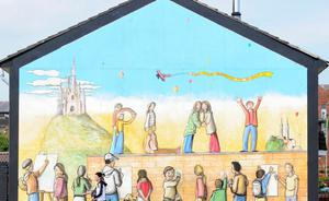 The new murals, designed to chart the social, cultural and industrial heritage of the lower Shankill