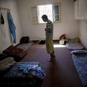 A man prays in a detention facility in Misrata, where new torture claims have been made (AP)