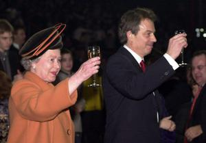 01/01/2000 Queen Elizabeth II and British Prime Minister Tony Blair raise their glasses as midnight strikes during the Opening Celebrations at the Millennium Dome in Greenwich, London. PRESS ASSOCIATION Photo.