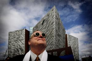 Eric Kuhne from CivicArts in London the  architect behind the new Titanic Belfast visitor centre strikes a pose outside the guilding, the world's largest Titanic-themed attraction that was officially opened today in the old shipyard at Harland and Wolff, where the doomed liner was built