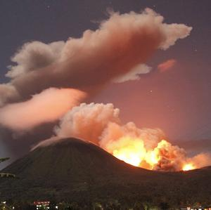 The glow of lava from Mount Lokon in Indonesia (AP)