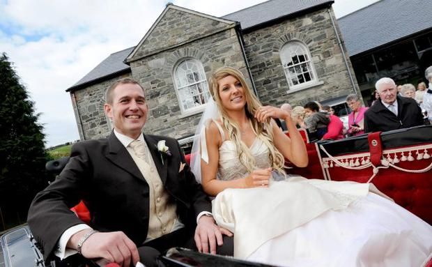 """Big day: Desi Gibson and Victoria McKibben were all smiles outside Edengrove Church in Ballynahinch. <p><b>To send us your Wedding Pics <a  href=""""http://www.belfasttelegraph.co.uk/usersubmission/the-belfast-telegraph-wants-to-hear-from-you-13927437.html"""" title=""""Click here to send your pics to Belfast Telegraph"""">Click here</a> </a></p></b>"""