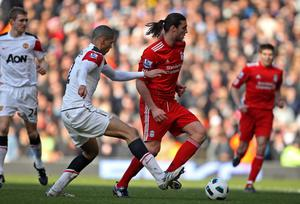 LIVERPOOL, ENGLAND - MARCH 06:  Andy Carroll of Liverpool competes with Chris Smalling of Manchester United during the Barclays Premier League match between Liverpool and Manchester United at Anfield on March 6, 2011 in Liverpool, England.  (Photo by Alex Livesey/Getty Images)