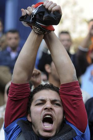 An Egyptian activist shouts anti-government slogans during a protest in downtown Cairo, Egypt, Wednesday, Jan. 26, 2011. A small gathering of Egyptian anti-government activists tried to stage a second day of protests in Cairo Wednesday in defiance of a ban on any gatherings, but police quickly moved in and used force to disperse the group. (AP Photo/Hossam Khalil)