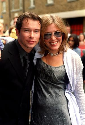 12/9/1999 of Cerys Matthews, singer with Welsh pop band Catatonia, and Stephen Gately, member of boy band Boyzone, at the New London Theatre, Dury Lane, in London