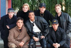 10/10/1996 Former Take That star Robbie Williams (bottom left) and pop star Peter Andre (bottom centre) join members of the Irish pop band Boyzone (left to right) Stephen Gately, Ronan Keating, Shane Lynch, Keith Duffy (front) and Mikey Graham,  for a photocall prior to the 1996 MTV Europe Music Awards in London