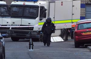 A bomb disposal officer near the device on the Limestone Road.