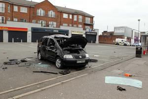 The vehicle which carried the main bomb still sitting on the Antrim Road yesterday.