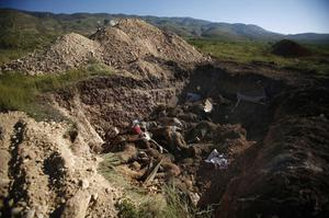 Bodies of earthquake victims lie in an open mass grave in Sous Pianet,  just south of Port-au-Prince