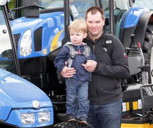 Balmoral Show on the opening day.  2010.  Nigel Dunlop from Hillsborough with his son Isaac