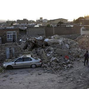 Ruins of houses are seen after an earthquake in the city of Varzaqan (AP)