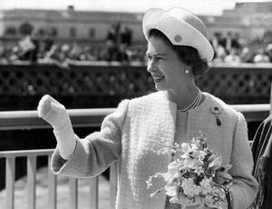 The Queen, Elizabeth 11. 1966 visit.The Queen waves to the cheering crowd as she walks across the Queen Elizabeth Bridge after sutting the tape for the official opening.  4/7/1966