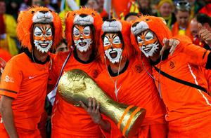 Netherlands fans enjoy the atmopshere ahead of the 2010 FIFA World Cup South Africa Final match between Netherlands and Spain at Soccer City Stadium on July 11, 2010 in Johannesburg, South Africa