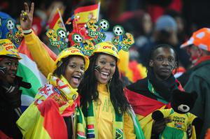 Football fans enjoy the atmosphere prior to the 2010 FIFA World Cup South Africa Final match between Netherlands and Spain at Soccer City Stadium on July 11, 2010 in Johannesburg, South Africa
