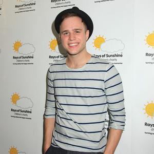 Olly Murs said the book will contain new gossip and previously unseen photos