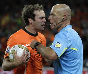 Netherlands' Joris Mathijsen, left, holds the ball as he argues with referee Howard Webb after Spain's Andres Iniesta scored during the World Cup final soccer match between the Netherlands and Spain at Soccer City in Johannesburg, South Africa