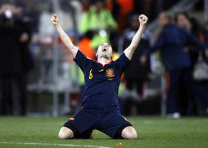 Spain's Andres Iniesta celebrates after scoring a goal during the World Cup final soccer match between the Netherlands and Spain at Soccer City in Johannesburg, South Africa