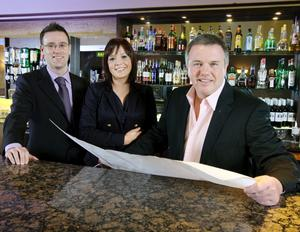 Gordon Davidson (left) and Lisa Allen from Ulster Bank study refurbishment plans for the pub