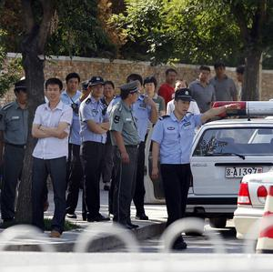 Chinese police man a checkpoint leading to the Bo Bo Freedom Town where Hu Jia, a Chinese dissident, lives in Beijing (AP)