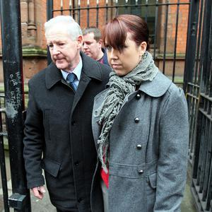 Brenda Finnegan, wife of Martin Finnegan, and his father Jim leave Belfast Coroners Court