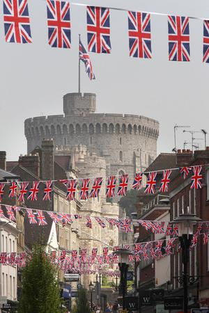 WINDSOR, ENGLAND - APRIL 21:  Union Jack flag bunting decorates a shopping street in sight of Windsor Castle on April 21, 2011 in Windsor, England. Prince William will marry Catherine Middleton in seven days time at Westminster Abbey in London.  (Photo by Peter Macdiarmid/Getty Images)