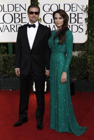 Angelina Jolie and Brad Pitt, left, arrive for the Golden Globe Awards Sunday, Jan. 16, 2011, in Beverly Hills, Calif. (AP Photo/Matt Sayles)