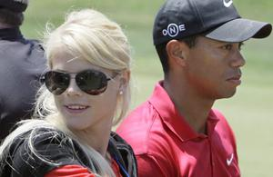 Tiger Woods' wife, Elin Nordegren, rides next to Woods after winning the US Open championship at Torrey Pines Golf Course